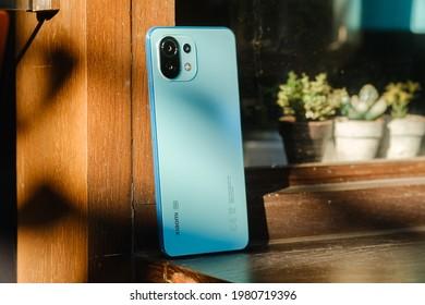 HO CHI MINH CITY, VIETNAM - May 27th, 2021: Review Xiaomi Mi 11 Lite 5G