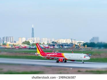 Ho Chi Minh City, Vietnam - May 20th, 2021: Cargo plane Airbus A321 of VietJet Air landing at Tan Son Nhat International Airport, Ho Chi Minh City, Vietnam