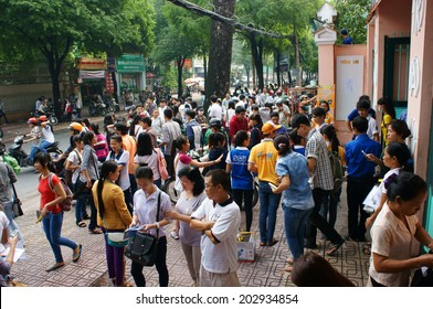 HO CHI MINH CITY, VIETNAM- JULY 5: Pupil finish exam time in examination season to select university for future, crowd of examinee leave school, Vietnam, July 5, 20134