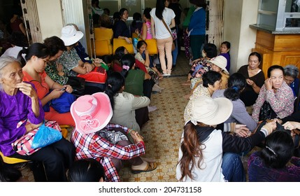 HO CHI MINH CITY, VIETNAM- JULY 9: Overload at Asia clinic, crowd of sick person standing, waiting to submit hospital fee, crowded of patient is situation, society problem, Viet Nam, July 9, 2014