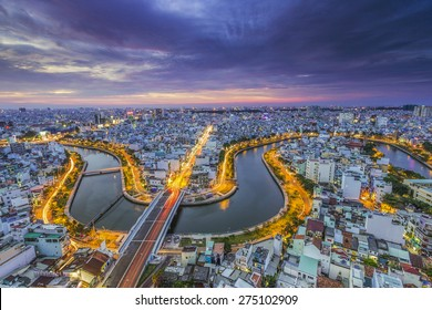HO CHI MINH CITY, VIETNAM - DEC, 17, 2014: Aerial sunset view of houses and Business and Administrative Center of Ho Chi Minh city on NHIEU LOC canal