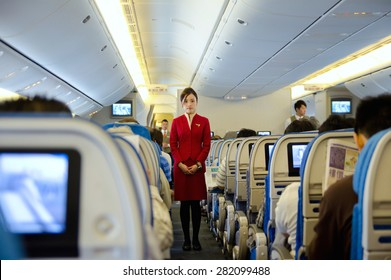 HO CHI MINH CITY, VIETNAM - MARCH 8: Unidentified stewardess of Cathay Pacific Airways gives preflight instructions at the flight to Hong Kong, March 8, 2013, Ho Chi Minh City, Vietnam.