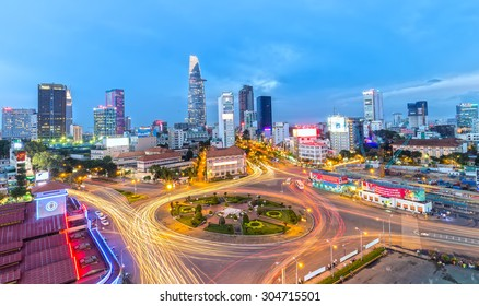 Ho Chi Minh City, Vietnam - July 23rd, 2015: impressive beauty, colorful traffic when the city lights up, the trail vehicle in crowded Quach Thi Trang roundabout, Ben Thanh, Vietnam
