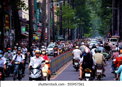 HO CHI MINH CITY, VIETNAM - SEPTEMBER 18, 2013: Road congested with motorists in Ho Chi Minh City (Saigon), Vietnam. There are approximately 340,000 cars and 3.5 million motorcycles in the city.