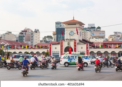 HO CHI MINH CITY, VIETNAM - FEBRUARY 2 2016: Cars and motorcycles rush around the Saigon Central Market known locally as Ben Thanh.