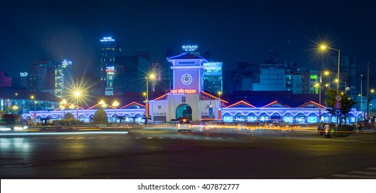 Ho Chi Minh City, Vietnam - September 17, 2015: Ben Thanh Market by night beauty in lights of vehicles and financial towers around.
