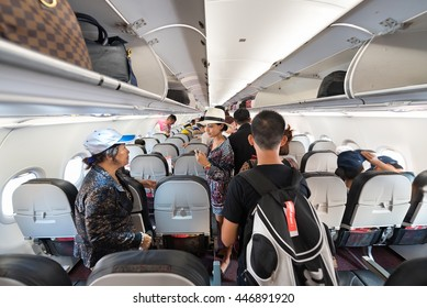 HO CHI MINH CITY, VIETNAM - MARCH 15, 2016: Unidentified people take seat in a Vietjet Air plane flying to Bangkok. VietJet Air is a young low coster in Vietnam.