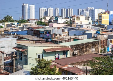 HO CHI MINH CITY, VIETNAM - MARCH 15, 2016. New modern social houses being built with old poor slum area in front. Social inequality in Vietnam