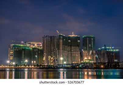 HO CHI MINH CITY, VIETNAM - 28 NOV, 2016: Sunset at VinPark, active construction site at Sai Gon river (Old Tan Cang New Port in Ho Chi Minh city, Viet Nam)