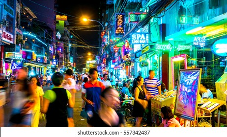 HO CHI MINH CITY, VIETNAM - MARCH 22, 2016: View of night street as people and cars pass by in the city formerly known as Saigon on March 22, 2016 in Ho Chi Minh City, Vietnam.