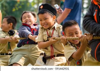 HO CHI MINH CITY, VIETNAM - DEC 29, 2013: Vietnamese boy scouts struggle while playing tug of war.