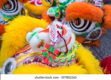Ho Chi Minh City, Vietnam - January 27, 2017: Lions and dragons are sticking amulet on the head to give luck for the new journey of the year at Thien Hau Pagoda, Ho Chi Minh City, Vietnam