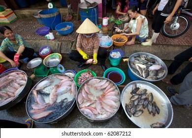 HO CHI MINH CITY, VIETNAM- CIRCA JUNE 2010: Street Vendor in Ho Chi Minh City, Vietnam selling fresh fish on the sidewalk (Ho Chi Minh City, Vietnam - CIRCA June, 2010)