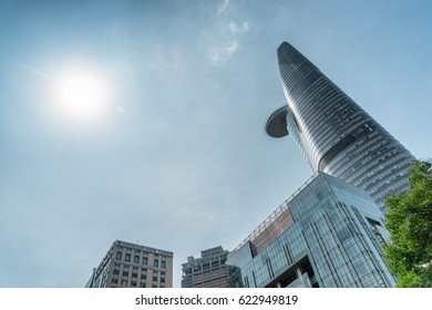 Ho Chi Minh City, Vietnam - February 23, 2017: Bottom view of modern buildings and famous skyscraper in Ho Chi Minh City. The Bitexco Financial Tower with helipad on blue sky background.