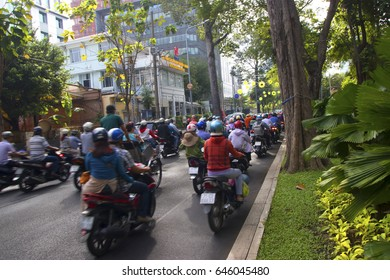 HO CHI MINH CITY, VIETNAM - FEBRUARY 22, 2017: traffic jam with a congestion of scooters and people with colorful helmets. There are approximately 340,000 cars and 3,5 million motorcycles in the city.