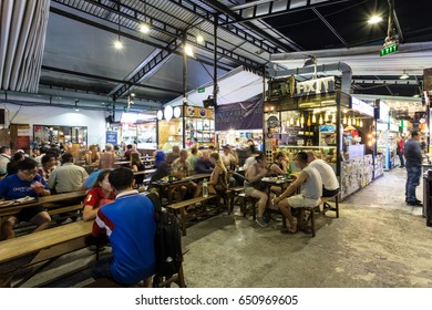 HO CHI MINH CITY, VIETNAM - APRIL 10, 2017: People have dinner in the covered Ben Thanh street food market in Ho Chi Minh City, Vietnam largest city formerly called Saigon.