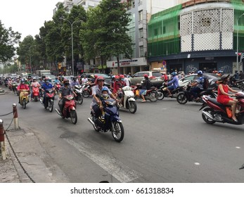 Ho Chi Minh City, Vietnam - June 17, 2017 : busy traffic with lots of motorcycles on street as major transportation mode
