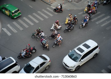 Ho Chi Minh City, Vietnam, September 9, 2017: Many of cars and motorbikes drive crossing the intersection. Traffic jam regularly happens in Saigon.