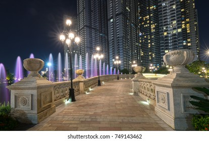 Ho Chi Minh City, Vietnam - November 30th, 2017: Panoramic view of skyscrapers at night with many sparkling lights, below is a central park showing urban development. in Ho Chi Minh City, Vietnam