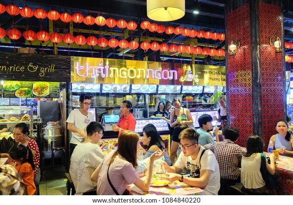 Ho Chi Minh City, Vietnam - April 29, 2018 :  People eating at  Food court, Asiana Fodd Town, Sense Market, Pham Ngu Lao Street.
