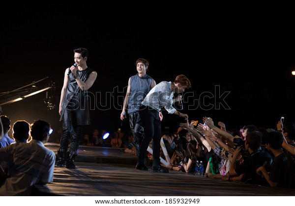 Ho Chi Minh City, VietNam - March 22: Nickhun , Chang Sung and Jun. K (2PM band) dance and sing on stage at the Human Culture Equilibrium Concert Korea Festival in Viet Nam on March 22, 2014.