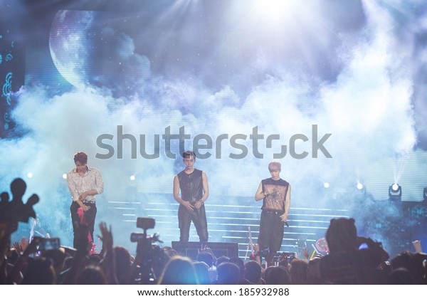 Ho Chi Minh City, VietNam - March 22: Chang Sung, Woo Young, Jun Ho (2PM band) dance and sing on stage at the Human Culture Equilibrium Concert Korea Festival in Viet Nam on March 22, 2014.