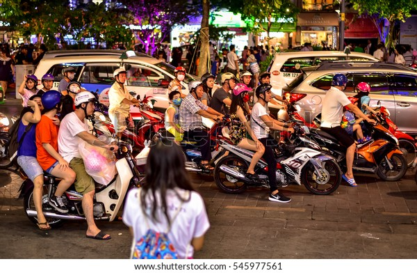HO CHI MINH CITY, VIETNAM - JULY 2016: Huge crowd of motorcycles in evening traffic