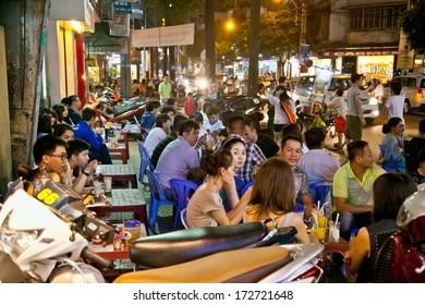 HO CHI MINH - NOV 18, 2013: A group of unidentified youth enjoying in Saigon's night life on Nov 18, 2013 in Ho Chi Minh city , Vietnam.