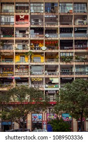 HO CHI MINH / SAIGON, VIETNAM, MARCH 12, 2018:  Apartment building with shops and business in Saigon.