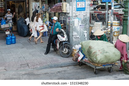Ho Chi Minh (Saigon), Vietnam: 16, August 2019. Street scene with Ho Chi Minh residents.