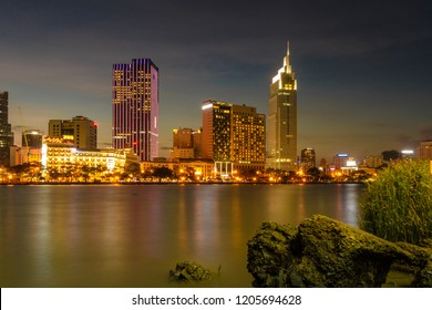 HO CHI MINH, THU THIEM TUNNEL, VIETNAM - APR 09, 2017: Cityscape of Ho Chi Minh at night with bright illumination of modern architecture, viewed over Saigon river in Southern Vietnam