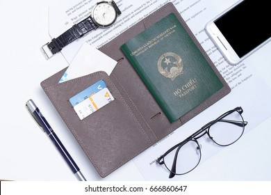 Ho Chi Minh, Viet Nam - June 5, 2017. Editorial: Concept passport, wallet, glasses, watches and smart phone.