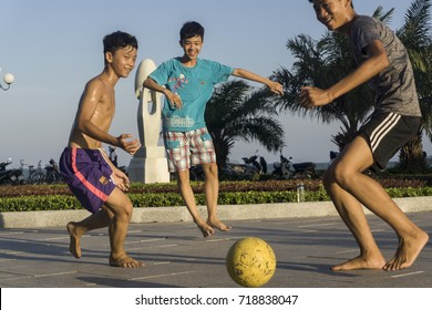 HO CHI MINH, VIET NAM - APRIL 30, 2017: Kids play football in the sun of summer