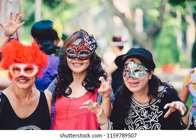 Ho Chi Minh, Vietnam - 06 2018:  Halloween day in a park. Royalty high quality free stock photo of halloween party with many woman making sinister faces. Women wearing as vampire, witch, dead bride