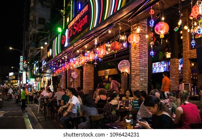 HO CHI MINH, VIETNAM - APRIL 25, 2018: Residents of Saigon relax after a hard day.