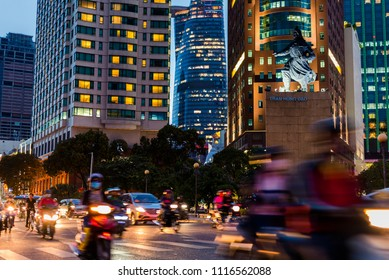 Ho Chi Minh, Vietnam - April 27, 2018: traffic in the street against Bitexco Financial Tower, Renaissance Riverside Hotel Saigon and Melinh Point Tower with Tran Hung Dao statue.