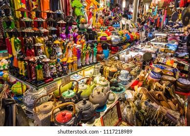 Ho Chi Minh, Vietnam - April 30, 2018: abundance of souvenirs (statuettes, teapots, etc) on shelves in a shop in Ben Thanh Market. Ben Thanh Market is a famous touristy shopping spot.