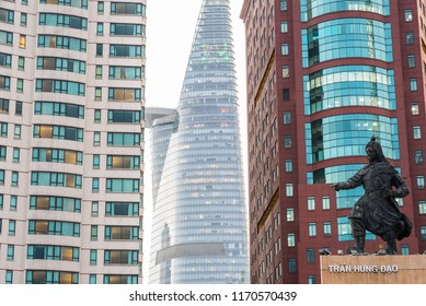 Ho Chi Minh, Vietnam - April 27, 2018: Bitexco Financial Tower (in the middle), Renaissance Riverside Hotel Saigon (on left) and Melinh Point Tower (on right) with Tran Hung Dao statue (bottom right)