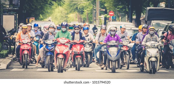 Ho Chi Minh, VIETNAM. August 07, 2017: Mopeds, scooters and urban traffic in Ho Chi Minh city, Vietnam. Starting at the traffic light. Panoramic view.