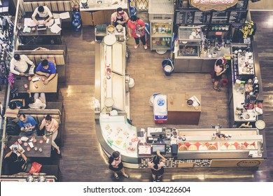 HO CHI MINH, VIETNAM. August 07, 2017: Coffee shop and restaurant with kitchen and people sitting at tables inside the shopping mall of Ho Chi Minh in Vietnam. Seen from above with drone.
