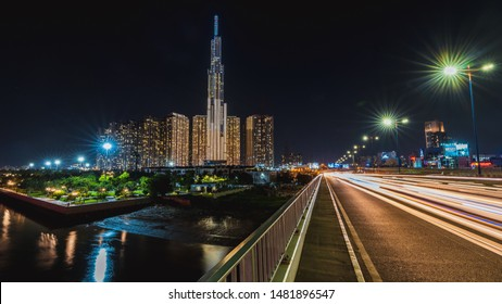 Ho Chi Minh, Vietnam - August 19th 2019: Beautiful night cityscape of Ho Chi Minh city with beautiful lights from motorbikes and buildings. Landmark 81 on the background behind Saigon river.