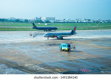 Ho Chi Minh, Vietnam - August 8, 2019. Airbus A321 of Vietnamairlines, Airbus A320 of Jetstar Pacific and Car carrying stairs onTan Son Nhat Airport (SGN) in Saigon (Ho Chi Minh), Vietnam.