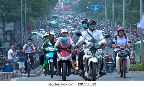 HO CHI MINH,  VIETNAM - CIRCA NOVEMBER 2018 : View of HEAVY RUSH HOUR TRAFFIC.  Many MOTORBIKE RIDERS on the busy road.