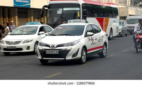 HO CHI MINH,  VIETNAM - CIRCA NOVEMBER 2018 : VINASUN TAXI at the street.  Famous taxi company in Vietnam.