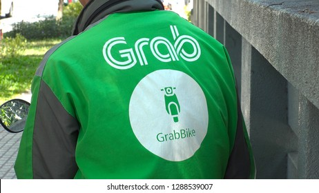 "HO CHI MINH,  VIETNAM - CIRCA NOVEMBER 2018 : ""GRAB"" MOTORBIKE BIKE TAXI at the street.   It offers ride-hailing service through its app."
