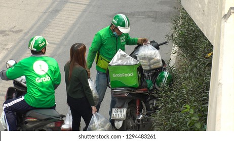 "HO CHI MINH,  VIETNAM - CIRCA NOVEMBER 2018 : ""GRAB FOOD"" MOTORBIKE at the street.  Food delivery service through its app."