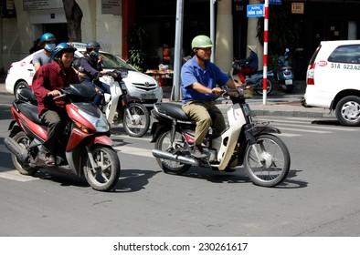 HO CHI MINH, VIETNAM - CIRCA OCTOBER 2014: Unidentified vietnamse men are riging their bikes in Ho Chi Minh city, circa October 2014.