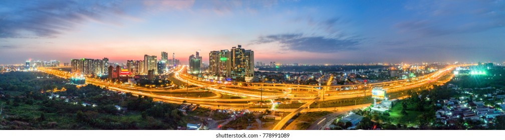 HO CHI MINH, VIETNAM - DEC 19,2017: Royalty hight quality free stock image Aerial view of a beatiful skyscaper along the river light smooth down urban development near Ho Chi Minh City Vietnam.