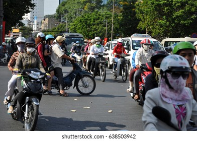 HO CHI MINH, VIETNAM - FEBRUARY 16, 2013: Chaotic road traffic in Saigon. In the biggest city in Vietnam are more than 4 mil. motorbikes, the traffic is often congested and the air is polluted