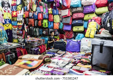 HO CHI MINH, VIETNAM - FEBRUARY 22, 2017: Unidentified man in the store at Ho Chi Minh, Vietnam. Ho Chi Minh is the largest city in Vietnam.